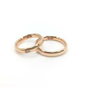 Fedi Polello in oro rosa e diamanti Infinito